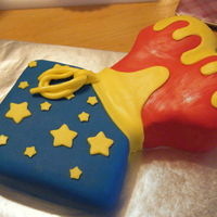 Wonder Woman Corset Cake  Got the idea for this cake via YouTube. The bustier is a round red-velvet cake and the pants is a square yellow cake. Both are crumb coated...