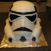 Erich's Storm Trooper Bithday Cake White cake, bannana butter cream filling. Rice treats for lower side of helmet. covered in fondant.