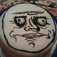 Me Gusta Cake Chocolate cake with strawberry filling. Cream cheese frosting covered in fondent. Face is done with black frosting.