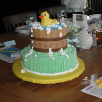 Rubber Duckie Cake Carrote cake with cream cheese frosting, Tub is fondant, soap bubbles are cream cheese frosting. Duck is rice treats covered in fondant.