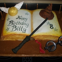 Harry Potter Cake  Lemon sponge cake not torted, covered in fondant with solid fondant/gumpaste mix Sorting Hat, Golden Snitch and Magic Wand. Board covered...