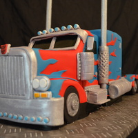 Optimus Prime  I made this for my boss, His wife asked me to make him a cake as he's never had a 3D cake himself lol. I was up for the challenge and...