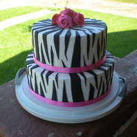 Zebra Print   this was made to match a diaper bag at a baby shower. Basic cake flavors with vanilla BC, fondant stripes, gumpaste flowers. TFL