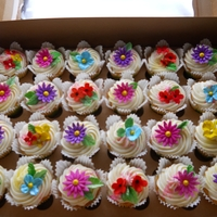 Spring Baby Shower vanilla cupcakes with cream cheese frosting. bright gum paste assortment of flowers