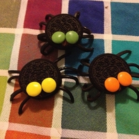 Spider Oreos Oreos with liquorice strings and Smarties. Easy and scaryyyy!:-)