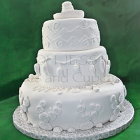 Baptism Mexican Style The customer requested and all white cake with a mexican theme for her son's baptism.