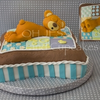 Baby Bear Banana foster cake covered in fondant and fondant details. Beat made out of fondant.