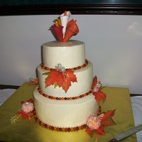 Fall Themed Wedding Cake My first wedding cake for my brother. Gumpaste calla lilies, MMF balls around the cake, white vanilla bean cake, raspberry filling, and...
