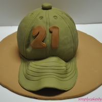 Baseball Cap Cake This was a 21st birthday cake. Chocolate cake with strawberry cream filling.