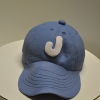 "Baseball Cap Cake Chocolate cake with mocha buttercream. The brim was made of gumpaste and took days to dry off. The cake is a 8"" round cake that I..."
