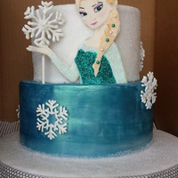 Elsa My first Frozen cake for my friend's daughter. Hand painted gum paste Elsa with royal icing snow flakes.