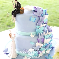Butterflies Wedding cake for a former high school classmate. She loves butterflies and her husband loves to fish.