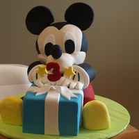 Mickey Mouse Present Cake  I made this cake for my son's 3rd birthday who just loves Mickey Mouse! The present, body and head are white choc mud cake, with white...