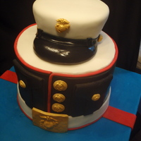 Usmc Retirement Coconut cake with coconut frosting, Cover is made of RKT. Thanks to LuluSweetArt for the inspiration!