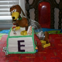Slinky Dog Yellow and chocolate cake covered in fondant. Slinky dog is made out of RKT and covered in modeling chocolate. One of the guest bumped the...