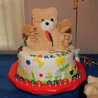 Build -A-Bear Build -A- Bear themed cake. Rounds are half chocolate hald yellow and the bear is pound cake.
