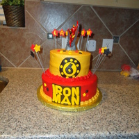 "Iron Man Cake This is my son's Ironman cake for his 6th birthday. It's 7' and 10"" rounds all white cakes. I got my inspiration from..."