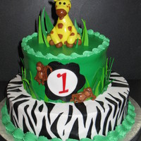 "Jungle 1St Birthday 9 & 6"" vanilla cake with buttercream icing and fondant accents. The giraffe is fondant with tylose added."