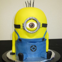 "Minion 6"" vanilla cake is about 9"" high. Covered with fondant and all decorations are fondant."