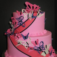 "Butterflies 9"" and 6"" chocolate cake with chocolate buttercream filling and pink buttercream finish. Butterflies are gumpaste cut with the..."