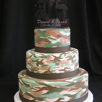 "Camo Grooms Cake 12"", 9"" & 6"" fondant covered chocolate cake with hand painted camo design."