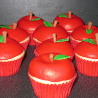 Buttercream Apples Vanilla cupcakes with buttercream apple. the stems and leaves are fondant.