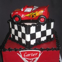 Lightning Mcqueen I made this as a gift for my friends little boy. Vanilla and chocolate cake with buttercream icing. Lightning is RKT covered with fondant...