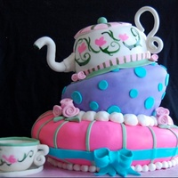Topsy Turvy Tea Party Cake Topsy Turvy Tea Party Cake. Everything edible. Gumpaste tea cup.