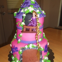 Rapunzel - Tangled Castle cake done in fondant with Rapunzel on the balcony.