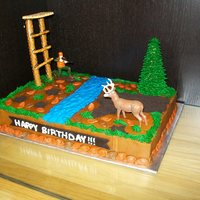 Hunting Cake All buttercream icing, except for leaves and banner which are MMF. Dirt is ground up oreos and the tree stand is made from pretzels glued...