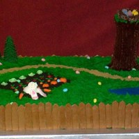 Easter Cake  This cake measures 22x30 inches. The fence, bunny, and vegetables are made of fondant. The garden is crushed oreos. The forest of trees is...