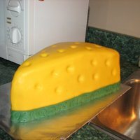 Packers Cheesehead This was made for a friend's Superbowl party. It is Red Velvet with buttercream filling and covered in MMF.