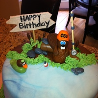 Beaver Fishing Birthday Cake Perfect cake for my OSU Beaver fan dad. It's a beaver fishing for a duck. All MMF decorations.