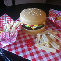 Hamburger & Fries This was for a local morning news program I was invited on. I showed the host how to make the mini burger cupcakes. This is a fondant...