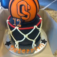 "Oregon State Basketball Cake Birthday cake for my nephew, who loves OSU Basketball! Used the wilton round pan for the ball and the ""hoop"" was 2-8""x3&quot..."