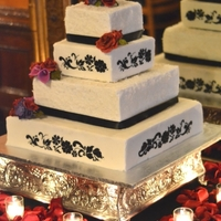 Romantic Wedding Cake...   Wedding cake with alternating tiers, first tier is frosted in coconut flakes, second is buttercream...