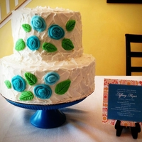 Baby Shower Cake~White Ripples With Teal Blue Flowers I made this for a friend for a baby shower. Super cute!
