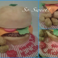 "Cheeseburger And Tater Tots Cake Fondant Condiments Burger Is Chocolate Rct And Tater Tots Are Fondant Covered Rct Ketchup Buttercream Cheeseburger and tater tots cake. Fondant condiments, burger is chocolate rct and tater tots are fondant covered rct. ""Ketchup""..."