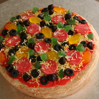 "Pizza Cake The ""crust"" is white fondant painted with food colouring, the ""sauce"" is buttercrem tinted red, the ""salami""..."
