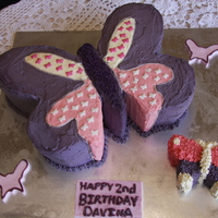 Purple And Pink Butterfly Cake For my niece's 2nd birthday. Butter cake covered in buttercream.