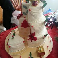 Merry Christmas!!!!!!!!!!!  This is a French Vanilla cake with ivory tinted fondant. Thank you Micheal and Myra for sending me a pic, I forgot to take one when...
