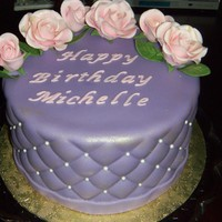 Lavender And Pink Birthday   Red velvet cake covered in fondant, that was quilted. Pink gumpaste roses. Thanks for looking!