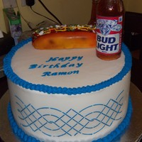 Birthday Chocolate cake with buttercream icing. The bottle was made of sugar, the hot dog was made with rice crispie treats covered with fondant and...