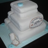 Spa Towels 3 tier lemon swirl cake with lemon curd/lemon cream cheese filling for a spa's grand opening.