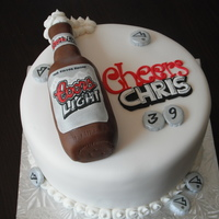 Coors Cookies and cream cake w/oreo mousse. Beer bottle make from RKT, hand painted label.