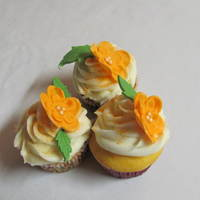 Orange Blossoms Cupcakes Orange cupcakes with mandrin oranges inside with orange cream cheese frosting and fondant flowers