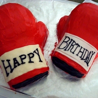 Practice Boxing Gloves  This was a practice cake for boxing birthday theme. I was trying out some techniques and fonts. These are carved cakes frosted in...