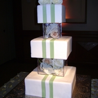 Square Glass Cake square glass boxes filled with flowers as seperators