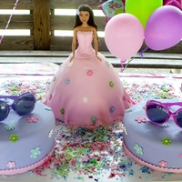 Barbie Doll Pink Barbie doll cake pan decorated in light colors of pink and purple, with two round chocolate cakes.
