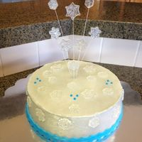 Snowflake Cake The snowflakes were made from isomalt then dusted with glitter. The cake was airbrushed silver. Blue border is fondant. Blue dots are royal...